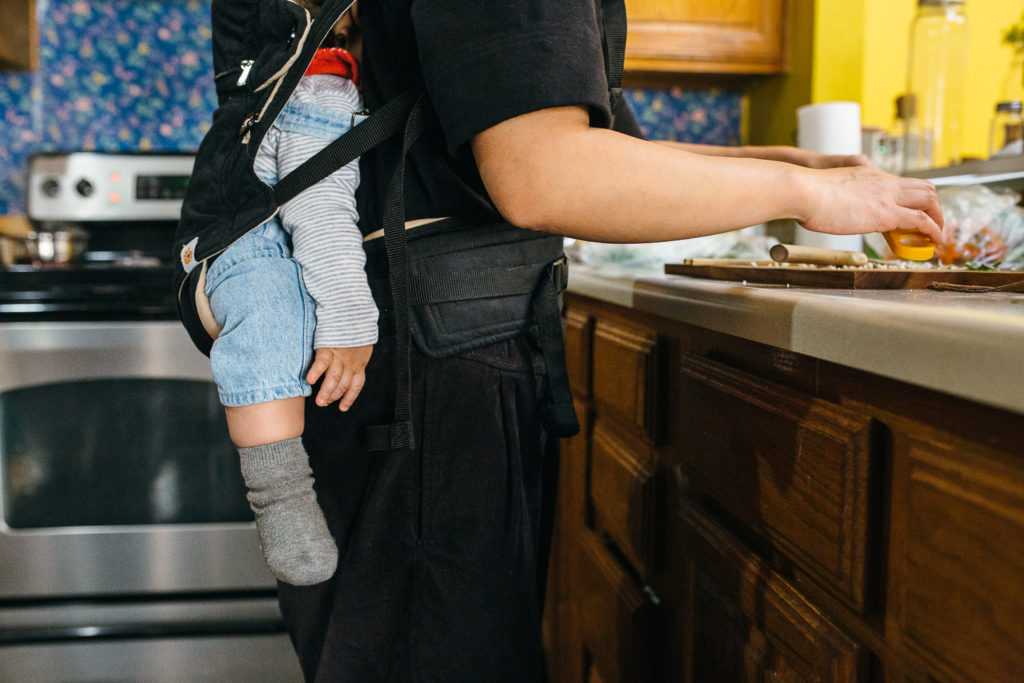 baby sleeping in the baby carrier