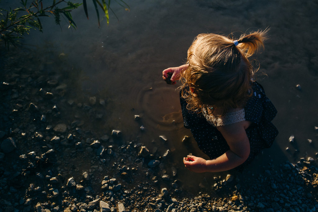 child playing in the water