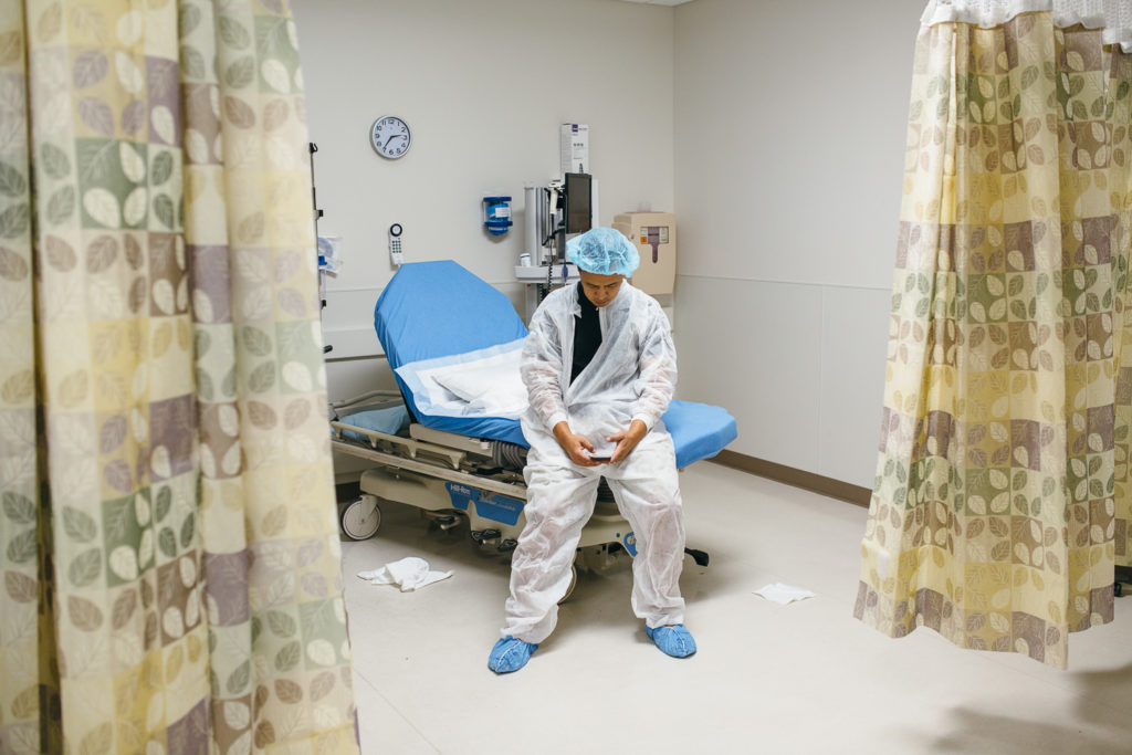 father waiting for c-section